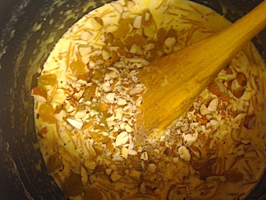 Mixing Nuts, Raisins, and Spices Into Finished Kheer